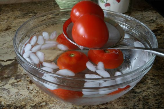 Plunge steamed tomatoes into ice water to remove skins with Tomato Dirt
